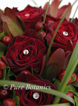close up of black baccara roses bouquet