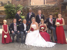 Bride, groom and wedding party having photographs in Coventry Cathedral