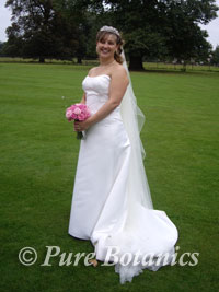 Bride holding a bouquet of pink roses