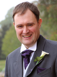 Groom wearing a calla lily buttonhole