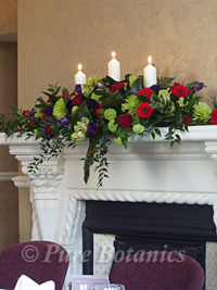 Corporate flowers over a fireplace