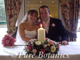 Happy couple celebrating wedding at Brandon Hall, Warwickshire