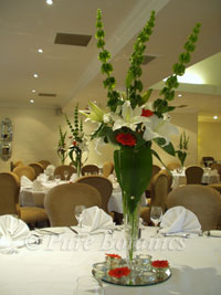 Tall table centerpieces for wedding at Brandon Hall Hotel, Warwickshire
