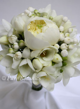 flower girl posy made with ivory white peony and freesia flowers