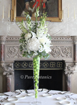 Ivory coloured tall centerpieces at Walton Hall, Warwickshire