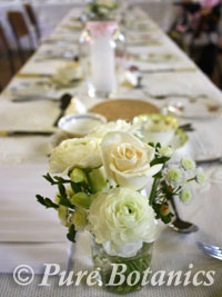 Flower posy on table at vintage wedding reception
