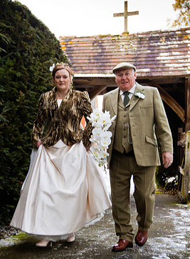 bride and father at winter wedding with orchid wedding flowers