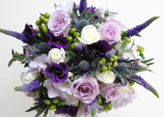 bridal bouquet made with Pacific blue roses and thistle and purple lisianthus