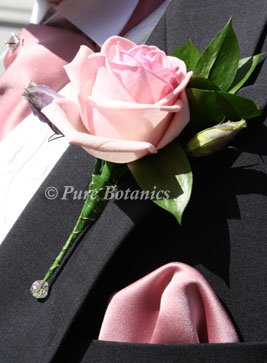 groom's buttonhole made from pink rose