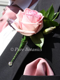 pale pink rose buttonhole for a wedding