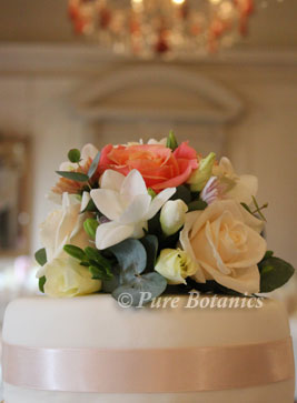 peach cream rose used as a stunning wedding cake topper