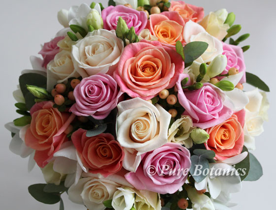 Rose posy bouquet in the colours of peach, pink and cream