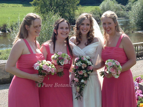 Pink bridal wedding bouquets held by bride and bridesmaids