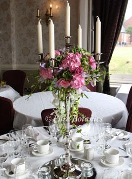 pink hydrangea decorated candelabras at walton hall, Warwickshire