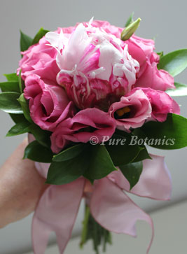 close up of flowergirl bouquet made with pink peonies and lisianthus