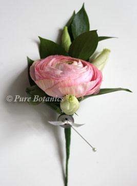 close up of pink ranunculus buttonhole