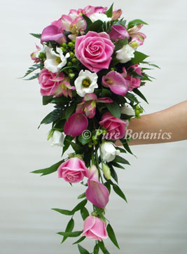 pink shower bouquet made with calla lilies