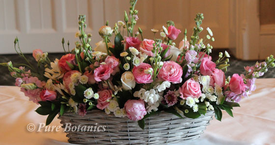 pink wedding flowers in a trough for a vintage spring wedding