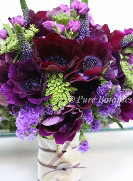 Dark purple anemone wedding bouquet with vintage button handle