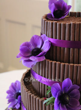 purple anemones on wedding cake to fit with Cadburys purple wedding theme