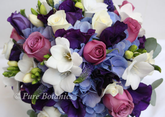 Purple and blue wedding bouquet featuring hydrangeas