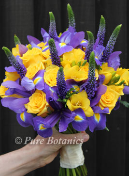 Yellow and purple bridal bouquet made with irises for wedding at Stoneleigh Abbey