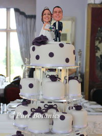 wedding cake decorated with purple decorations