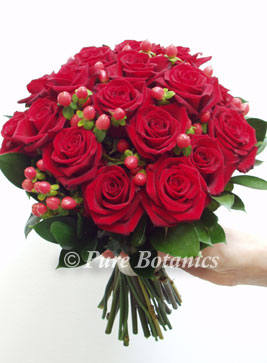 red wedding flower bouquet with passion roses
