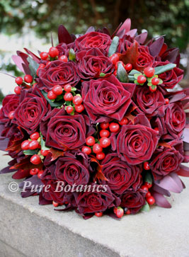 handtied wedding bouquet created using red roses