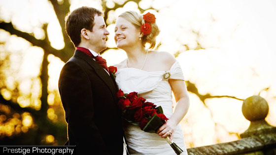 Red rose sheaf bouquet held by bride