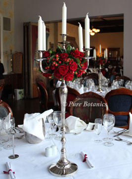 Wedding candelabras decorated with red roses