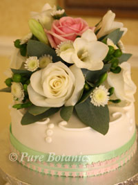 rose and freesia wedding cake topper