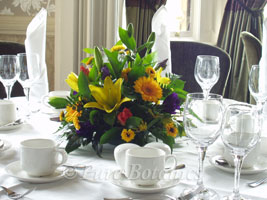 table centre with spring colours for business dinner