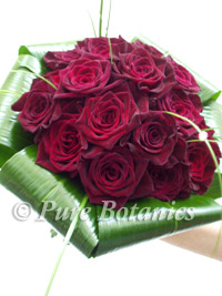 Black Baccara roses in a wedding bridal bouquet
