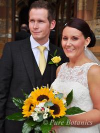 bride holding sunflower wedding bouquet outside Ettington Park