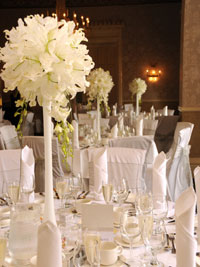 tall wedding centrepieces made with white lilies