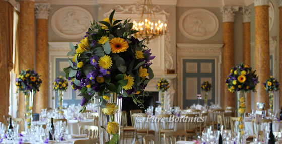 tall wedding table flowers in purple and yellow, Stoneleigh Abbey