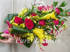 Tropical hand-tied sheath bouquet with roses and calla lilies