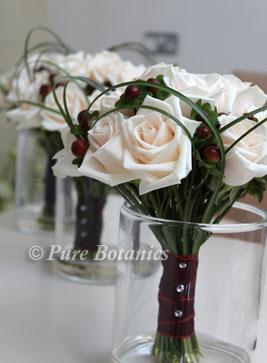 Cream vendella roses in bridesmaids bouquets