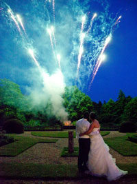 bride and groom watching fireworks at Wroxall Abbey