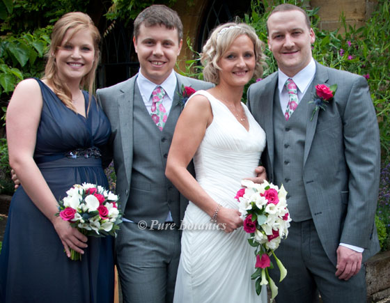 Wedding party with wedding flowers at the Manor Hotel, Moreton in Marsh