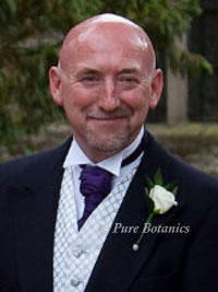 father of bride with white rose buttonhole