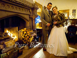 winter wedding at wroxall with couple by open fire