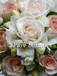 Cream roses in a wedding bouquet