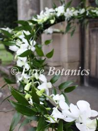 outside-church-wedding-flowers-on-handrails