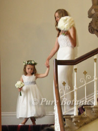 a bride and flowergirl with peony wedding bouquets