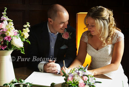 a couple with pure botanics wedding flowers