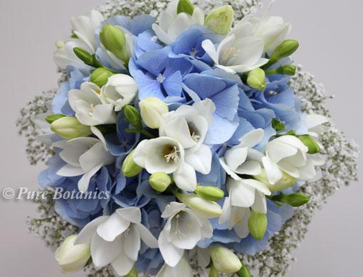 Blue hydrangea, gypsophila and freesia wedding bouquet.