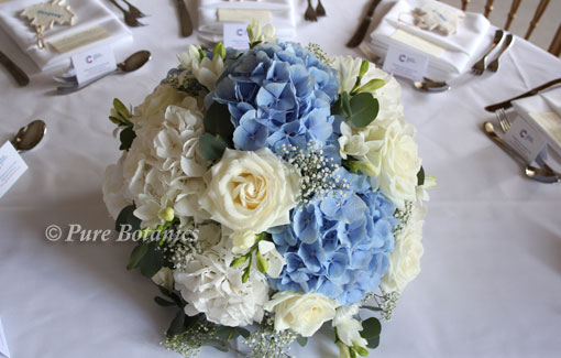 Large blue and white hydrangea posy arrangement for a wedding top table.