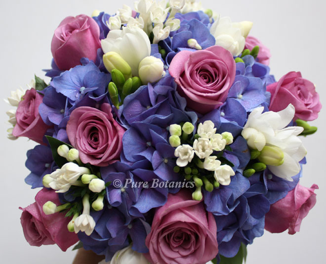 Combining hydrangeas and roses for a posy bouquet.